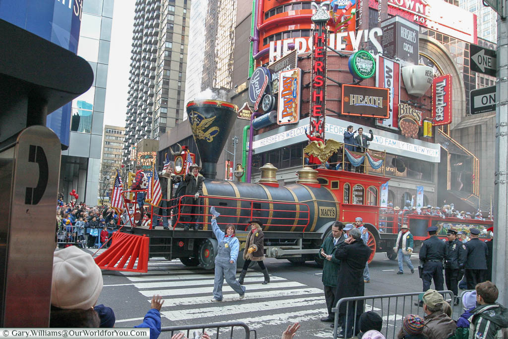 The Macy's Train float heading down Broadway in New York as park of the Thanksgiving Day parade