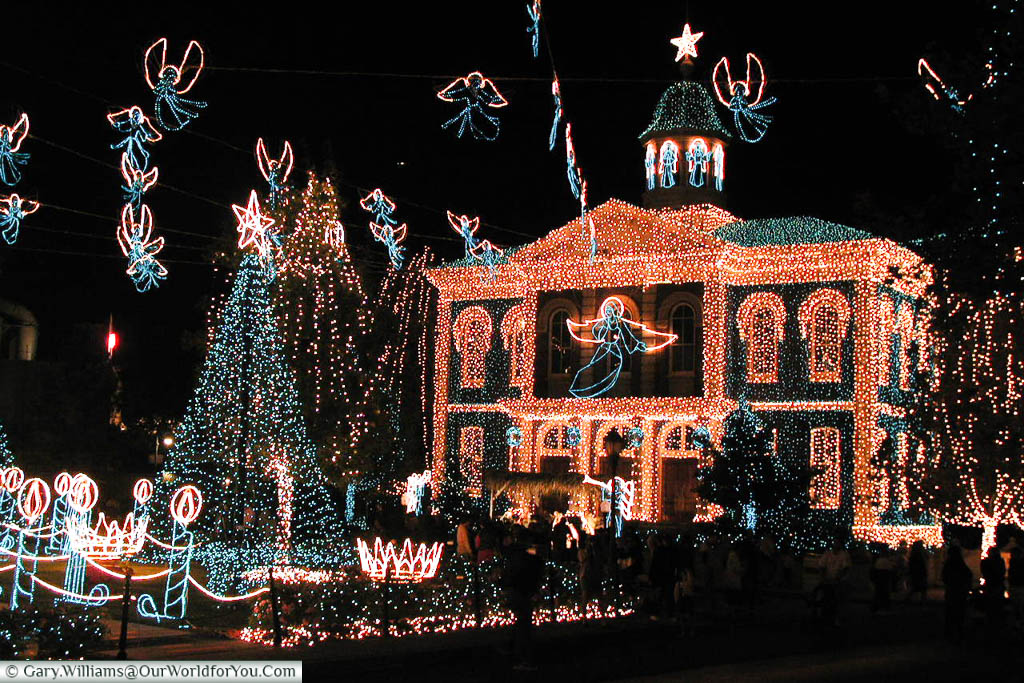 A fictional town hall at the MGM studios in Florida illuminated with fairy lights as part of the Osborne Family Christmas