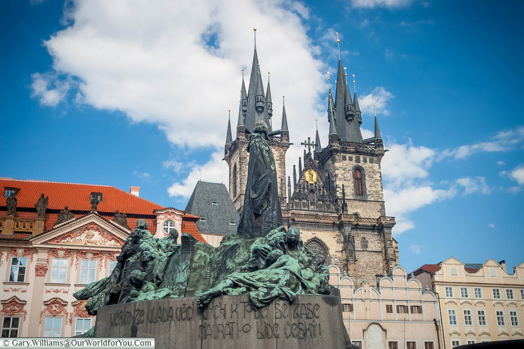 The Jan Hus Memorial in the centre of the old town square of Prague in front of the twin spires of the Church of Our Lady before Týn