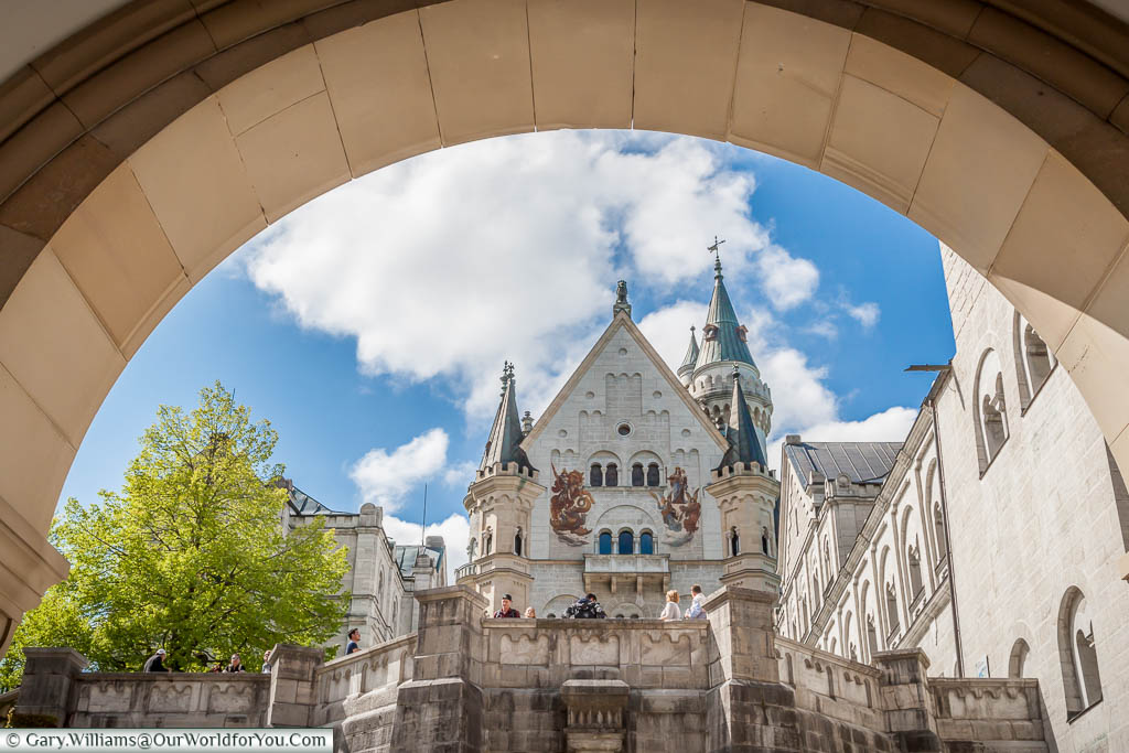The view through the arch, at the entrance of the fairytale castle of Schloss Neuschwanstein, to the inner courtyard.