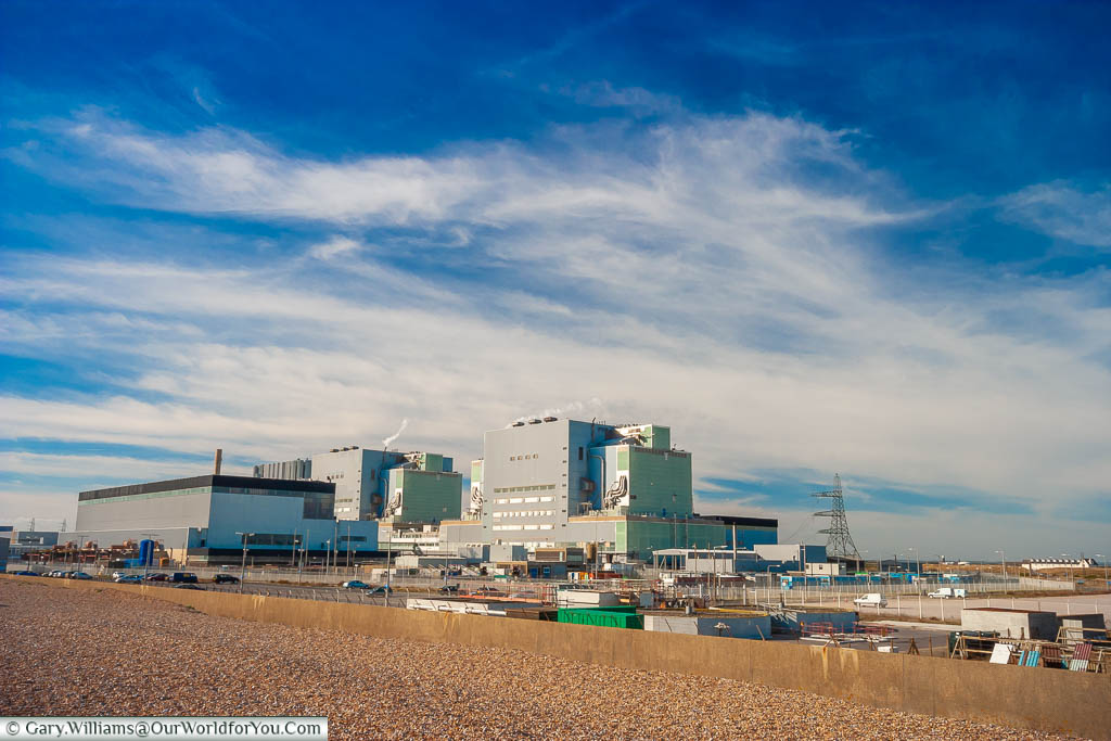 Both Dungeness Nuclear Powerstations behind a shale bank on the beach