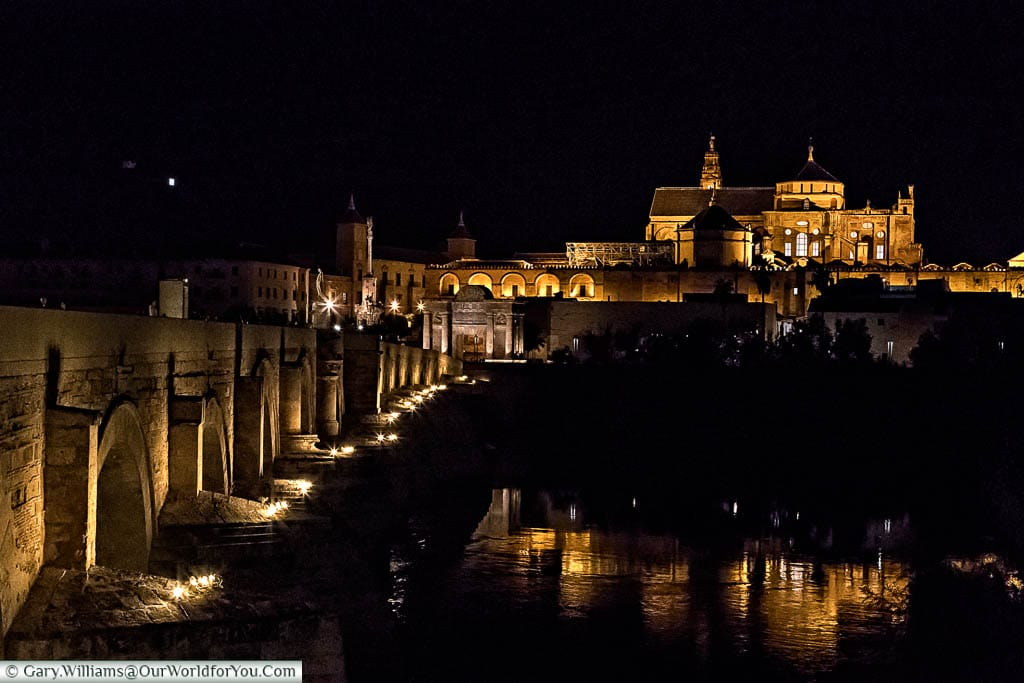 The view across the Roman Bridge of Corbada at night to the Mosque–Cathedral on the hilltop beyond