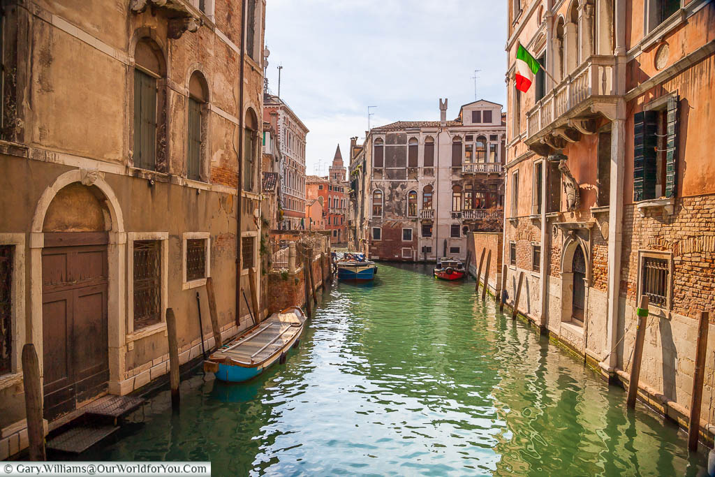 A look along a quiet canal in the early evening as the golden hues descend in Venice.