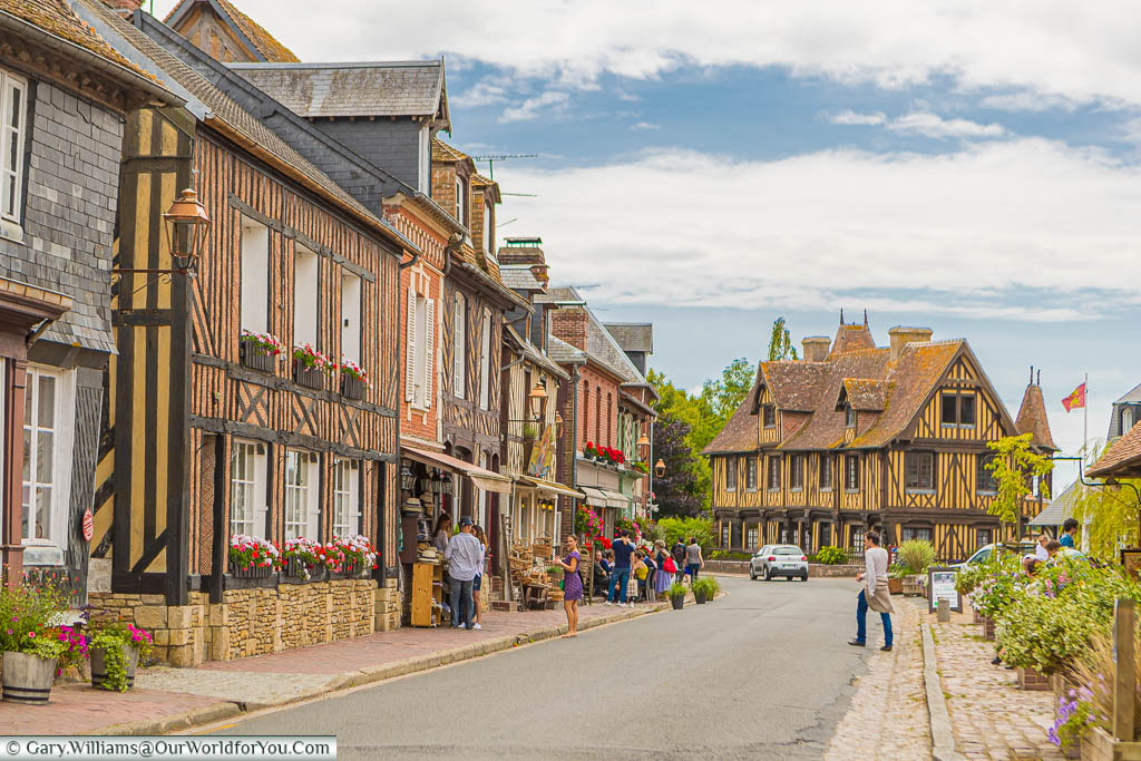 The main route through Beuvron-en-Auge, on Normandy's Route de Cidre, with half-timbered houses lining one side.
