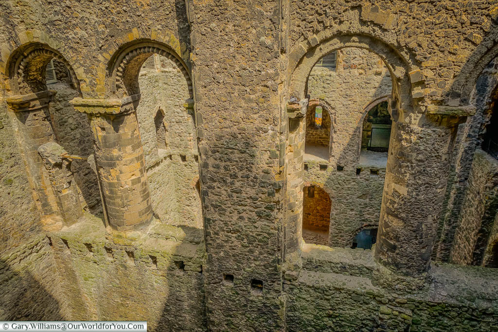 The raw stone arches inside of Rochester castle now open to the elements.