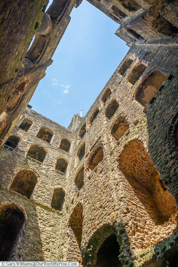 Looking up from the inside of the ruins of Rochester Castle to a bright blue sky