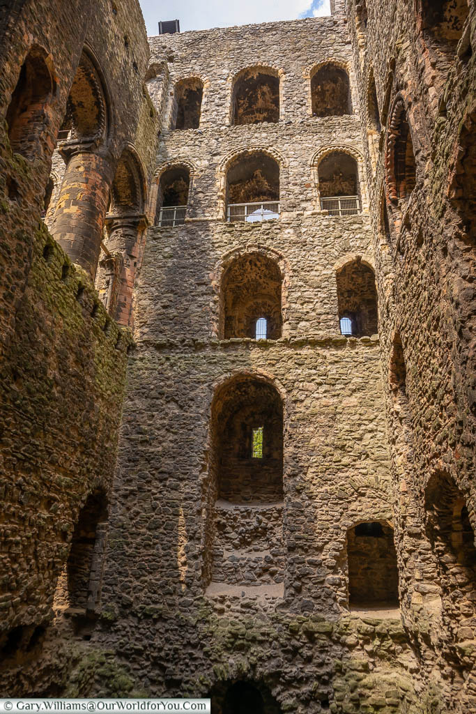 Looking at the inside of Rochester castle, with no floors separating the levels and just bare stonework
