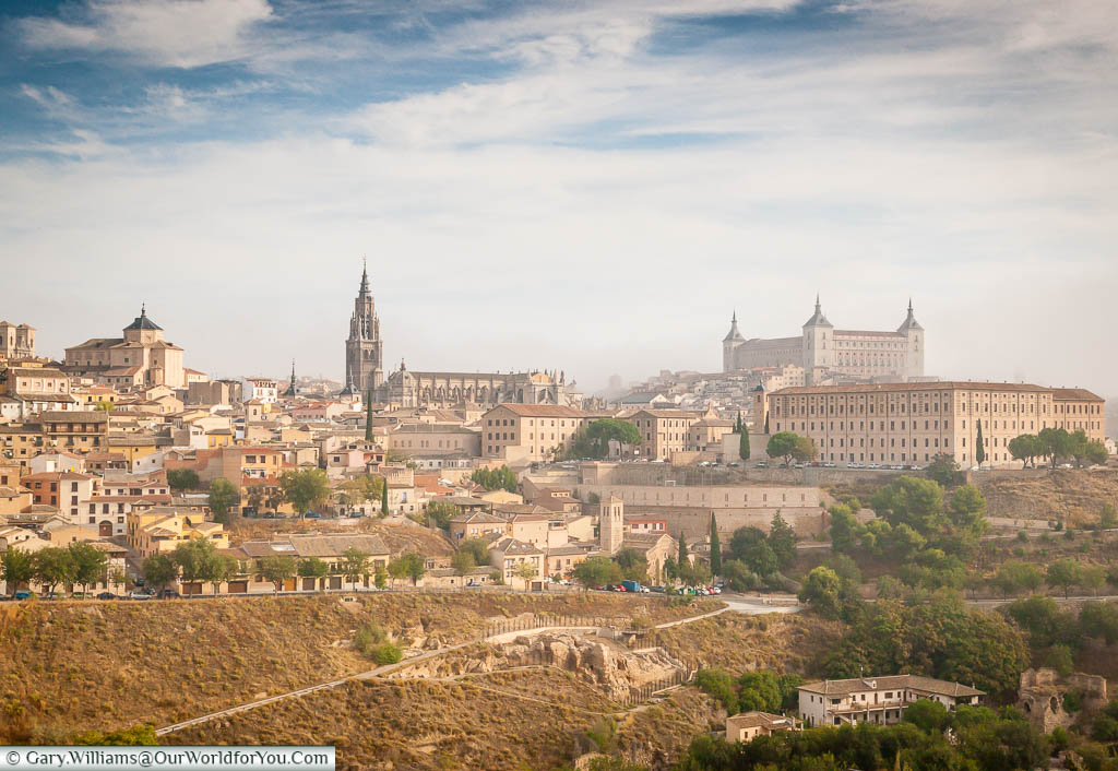 The view from a mirador just outside the centre of old Toledo, taking in a view of the city, high on the hill, with its Cathedral & Alcazar dominating the skyline