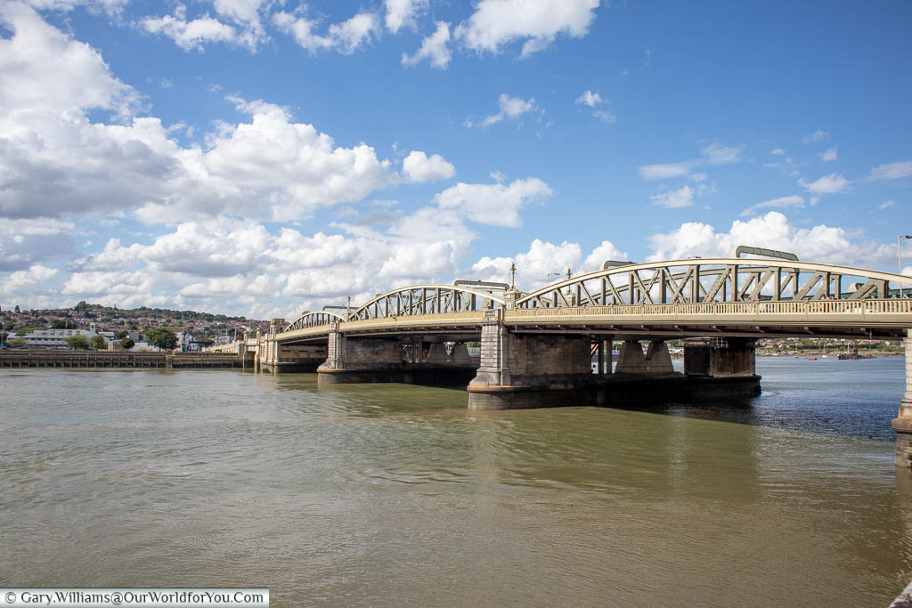 The early 20th Century cast-iron Rochester bridge spanning the river Medway.