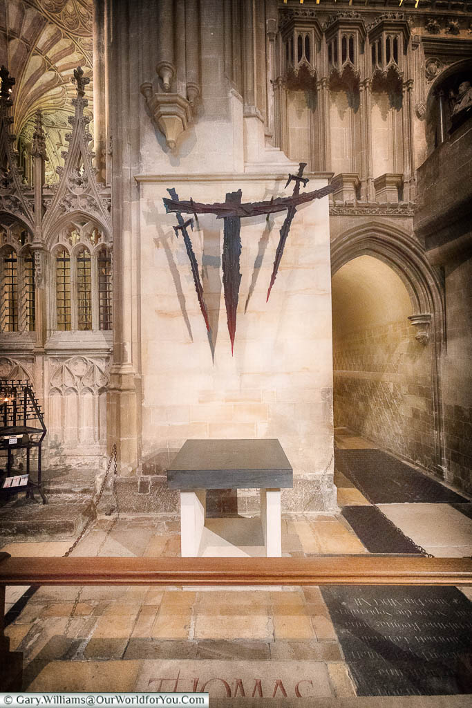 A modern art piece consisting of 3 medieval swords above the spot where Archbishop Thomas Becket was executed in Canterbury Cathedral.