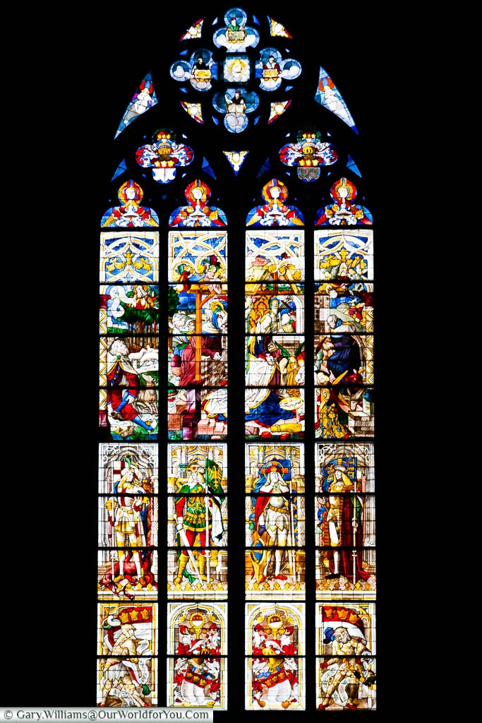 A detailed stained glass windows within Cologne's cathedral