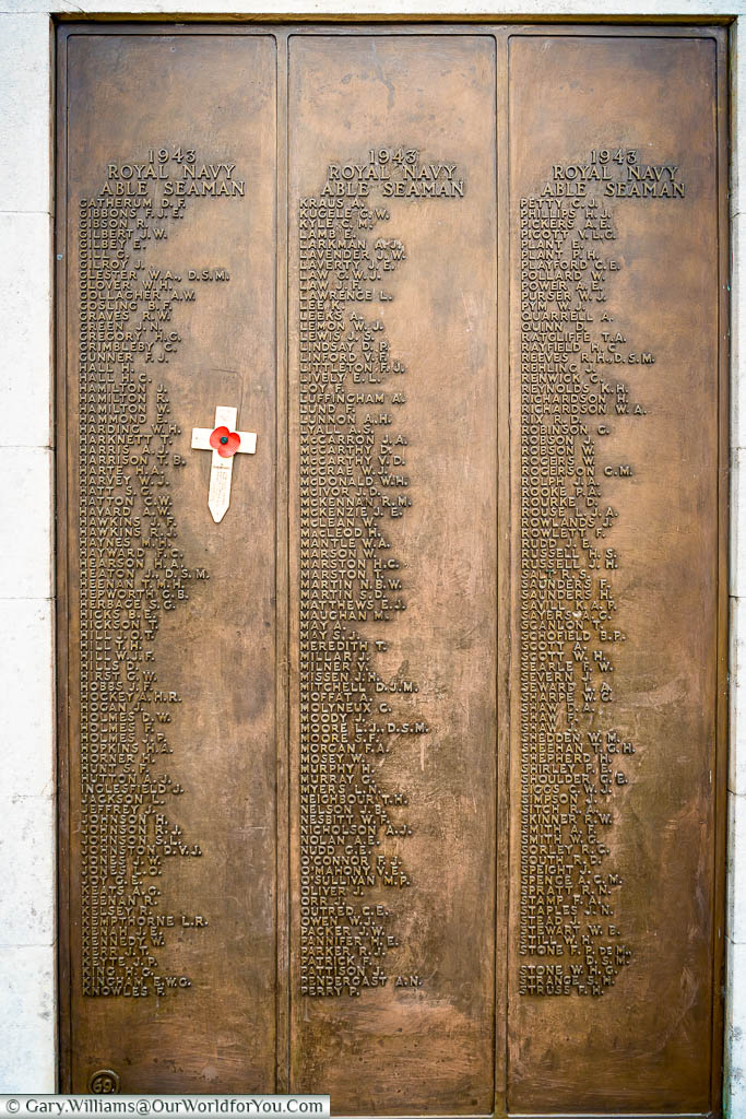 A closer view of one of the brass plaques attached to the outer arms of the Chatham Naval Memorial detailing around 150 of those who fell in battle