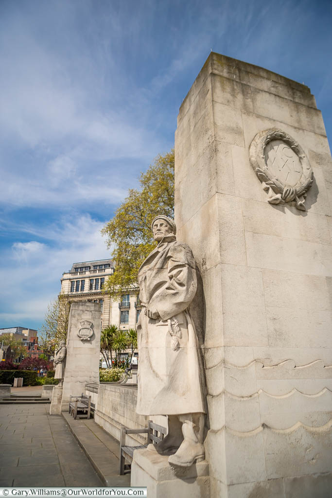 One of the stone Seaman at the Tower Hill Memorial in Trinity Memorial Gardens on Tower Hill, London