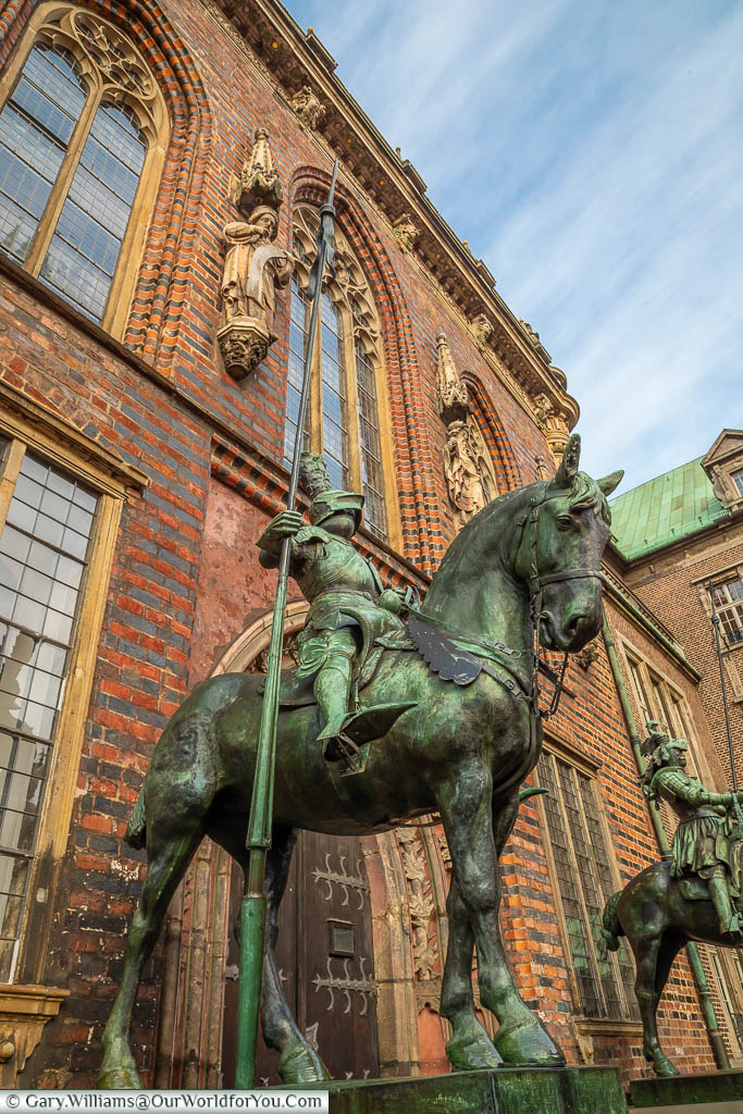 A bronze statue of a knight on horseback, standing guard at the entrance of Bremen's Townhall