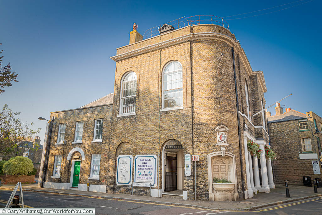 The beautiful brick-built, turn of the 19th Century, Deal Town Hall with its curved corner featuring what would have once been a water fountain, but now planted out.