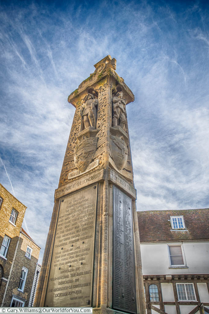 The stone war memorial in the Buttermarket area of Canterbury