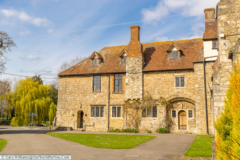A view from a corner of the Great Courtyard of Aylesford Priory, towards the willow tree in the duck pond.