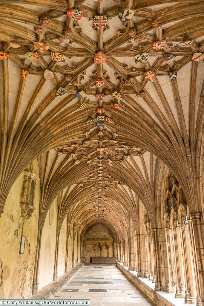 Heraldic shields line the ceiling of the Cloisters in Canterbury Cathedral