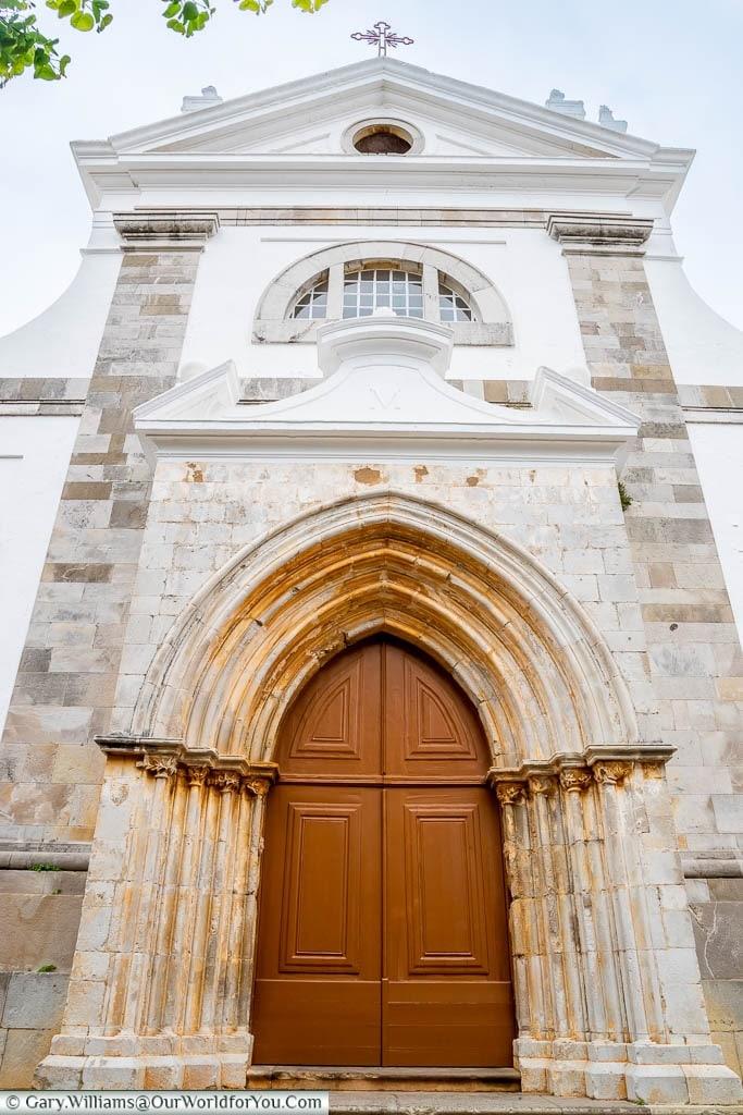 The massive door to the church of Santa Maria do Castelo in Tavira on Portugal's Algarve Coast.