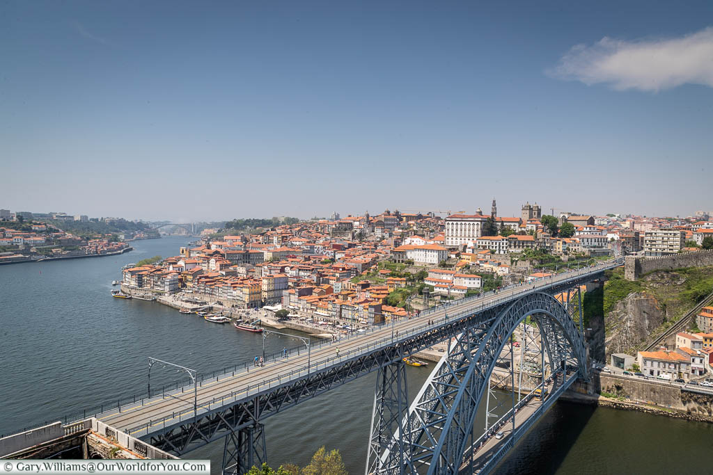 Looking across from the Miradouro da Serra do Pilar over the massive iron Luís I Bridge over the Douro River to the old town of Porto