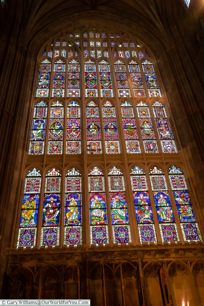 Light flooding through a stained-glass window in Canterbury Cathedral, Kent