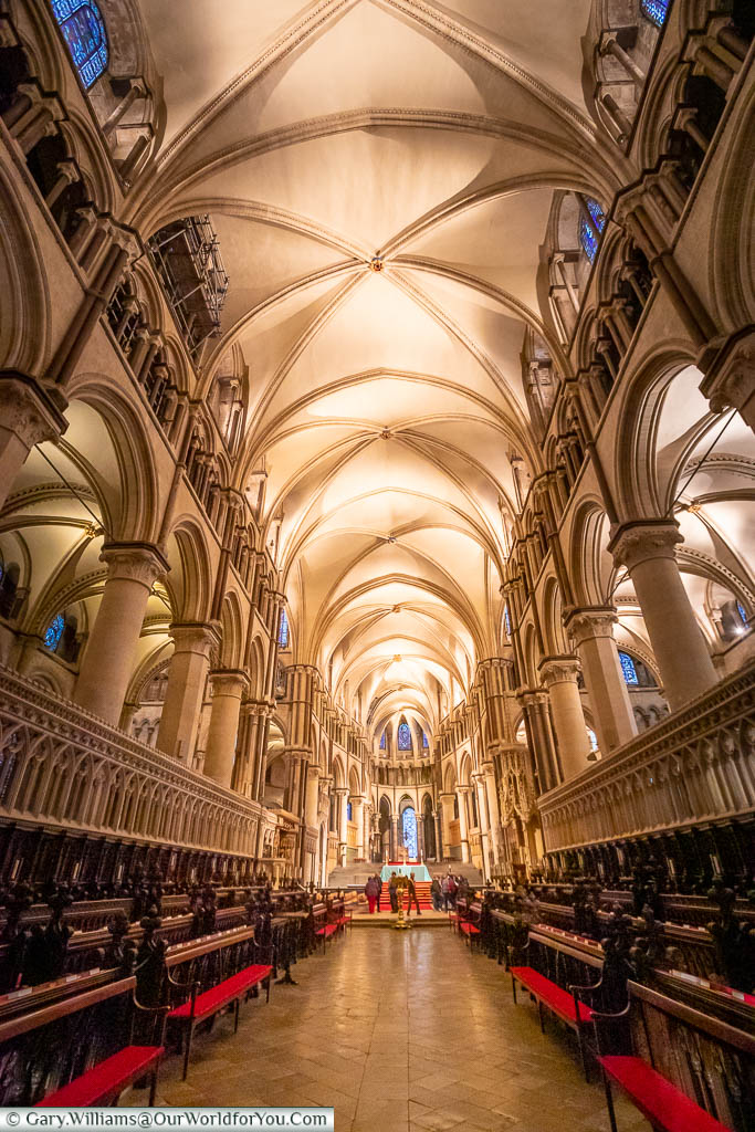 Looking towards the altar from the vaulted nave of Canterbury Cathedral.