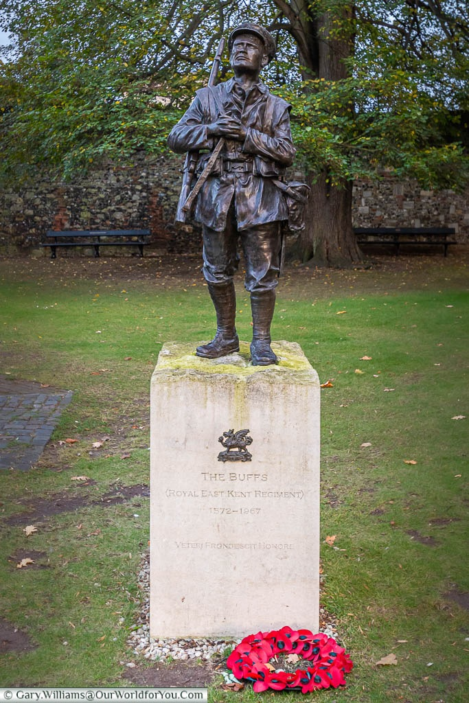 A bronze statue of a soldier from The Buffs in the Cathedral precinct