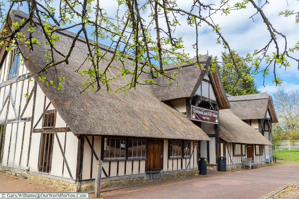 The Aylesford Priory tearoom and gift shop in a thatched, timber-framed barn.