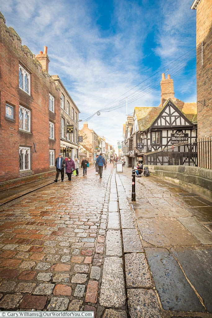 The cobbled High Street of Canterbury as it crosses the Great Stour River