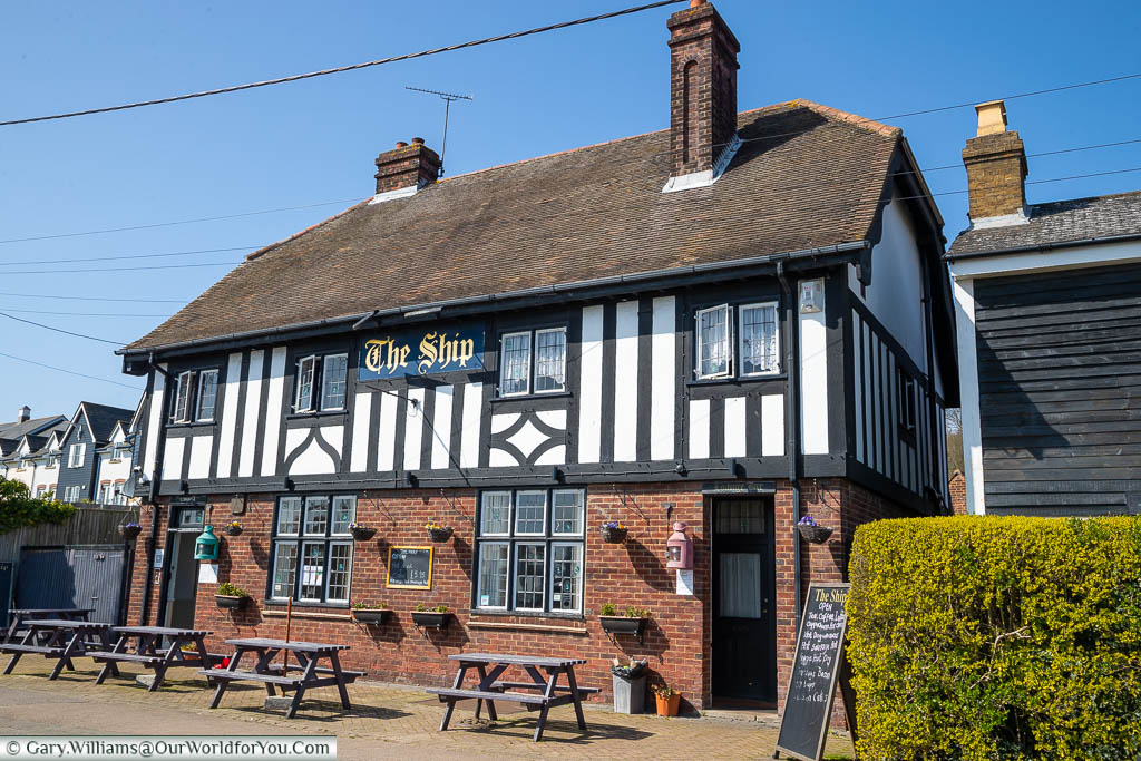 The Ship, a traditional looking, half-timbered pub set back from the only road through Lower Upnor