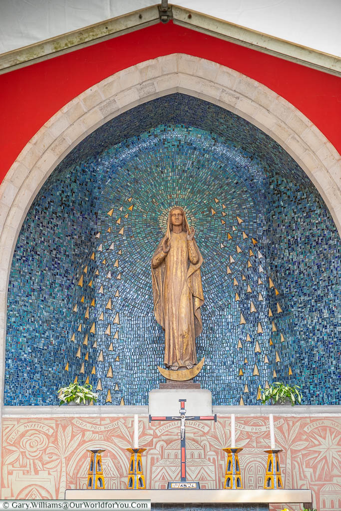 A statue to the Virgin Mary in the centre of the shrine in Aylesford Priory.