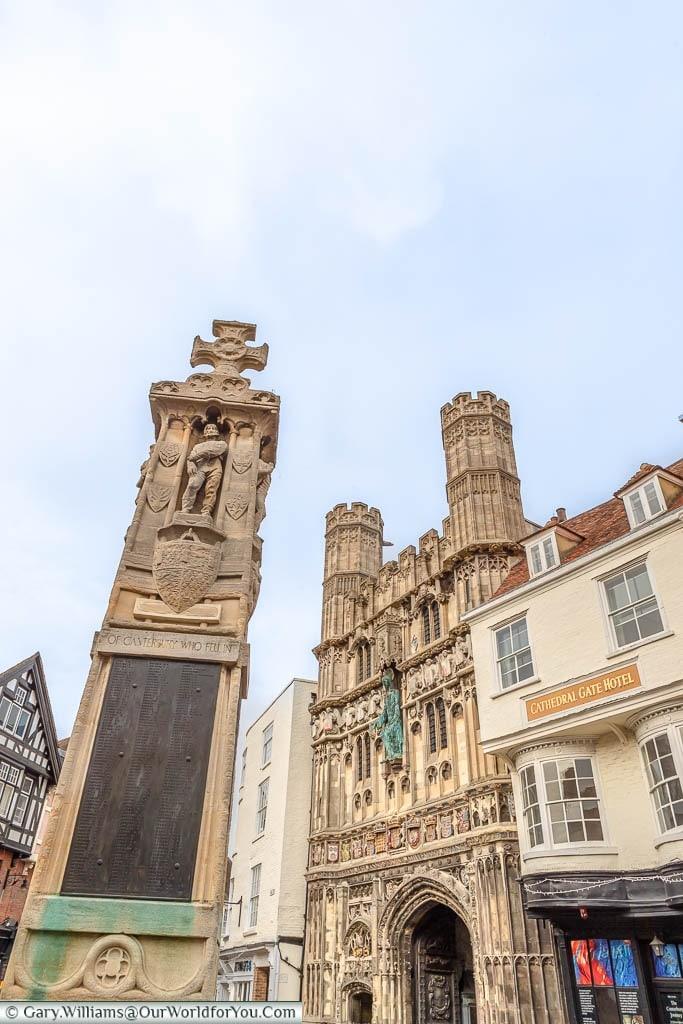 The stone War Memorial stands in front of the Christchurch gate that leads to Canterbury Cathedral in the butter market district of Canterbury.