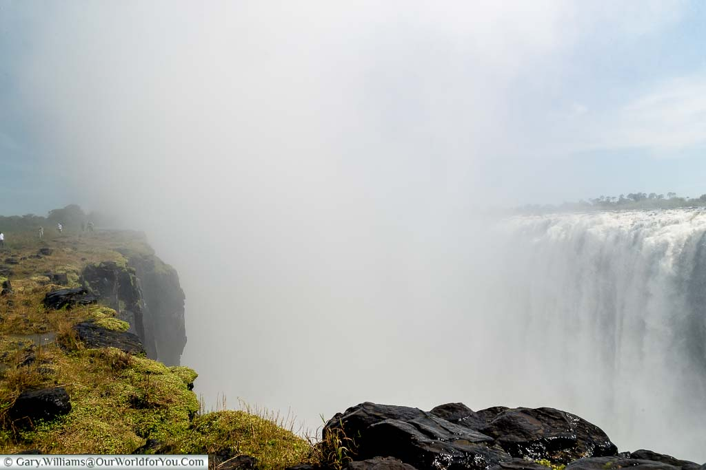 A heavy mist obscures the view back along Victoria Falls towards the Devil's Cataract