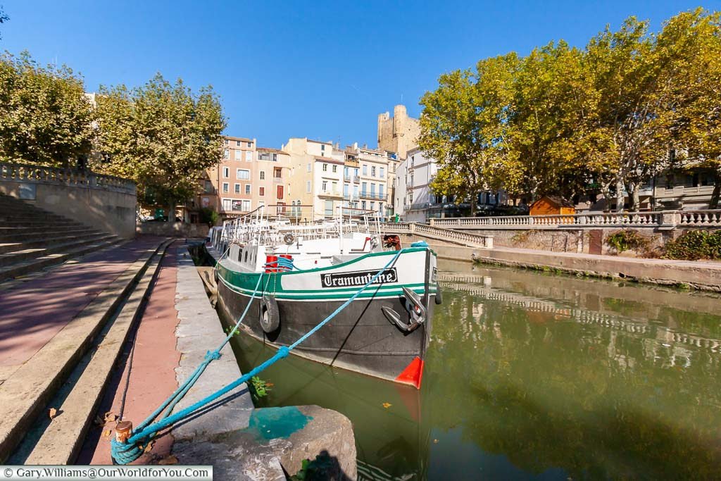 A canal boast moored up in the Canal de la Robine in Narbonne