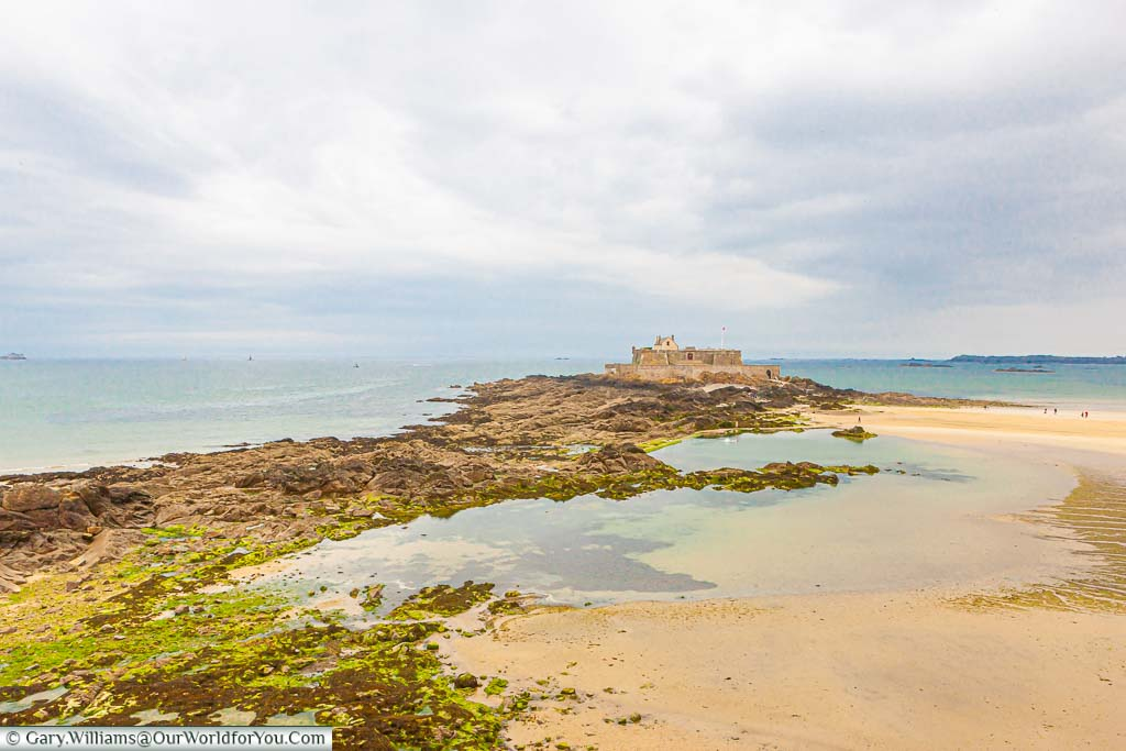 The remains of a fort on the tidal Island of Grand Bé, just off the shore of Saint-Malo in Normandy