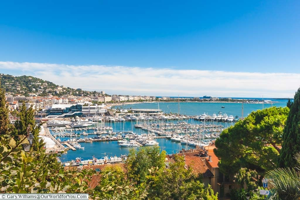 A view of the Cannes Harbour on the Côte d'Azur under a deep blue sky.