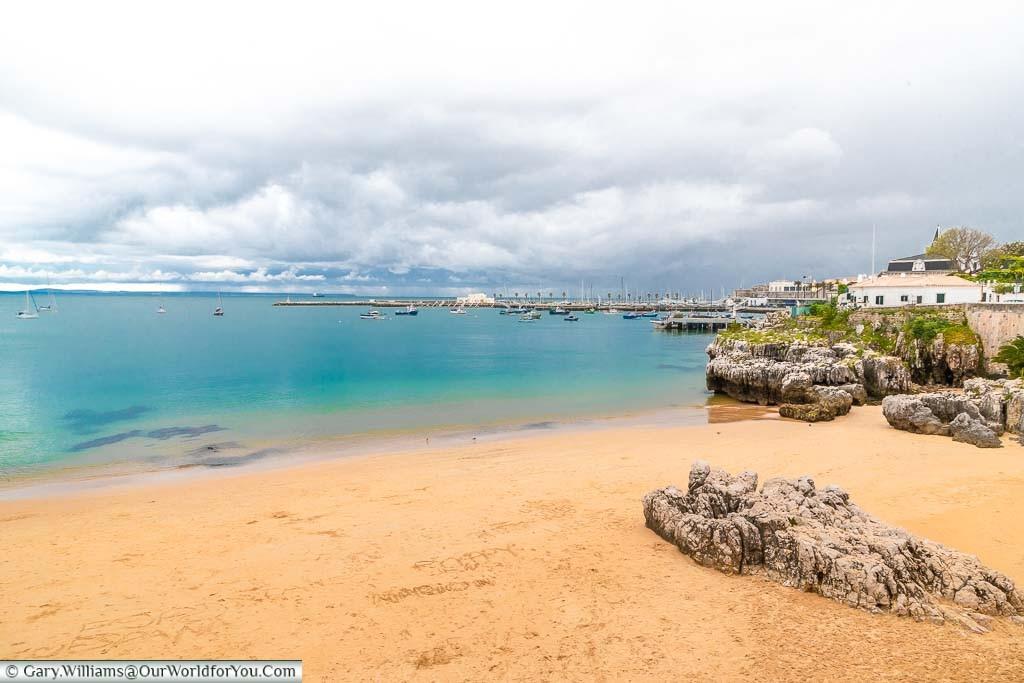 The small sandy beach of Praia da Rainha in Cascais, Portugal