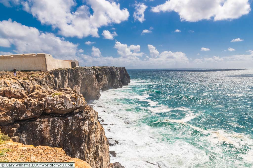 A fortress on the rocky outpost of Sagres, with waves crashing against the cliff face, at the southern tip of Portugal