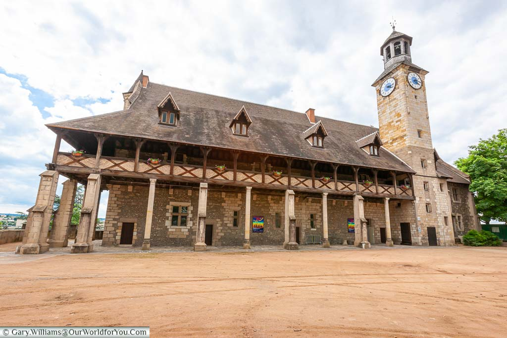 The restored Castle of the Dukes of Bourbon, with its wooden exterior gallery and adjoining clock & bellower.