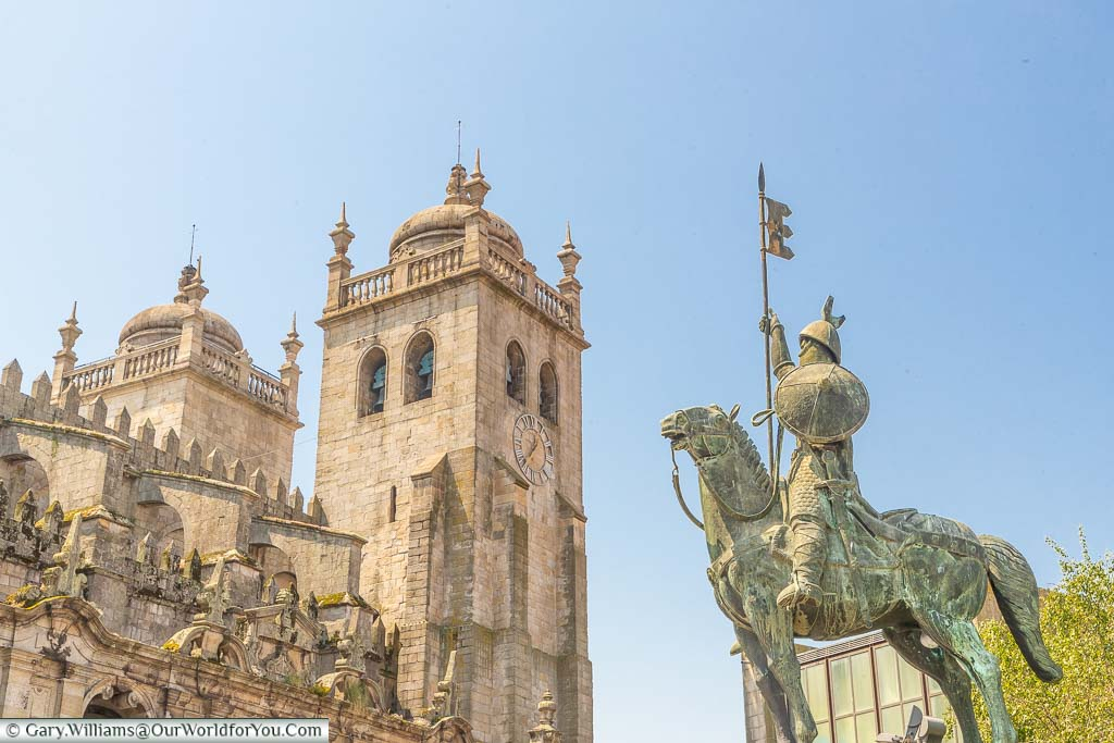 An equine statue of Vímara Peres in front of the gothic Porto Cathedral