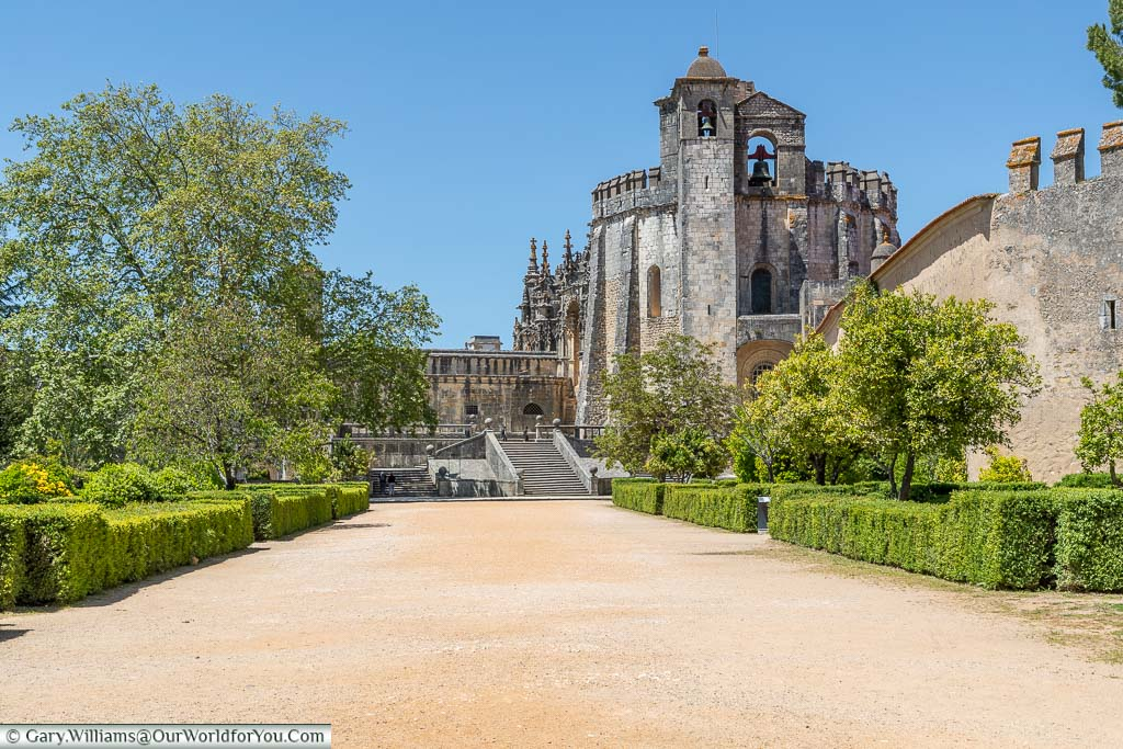 The dusty path leading to the ornate stone medieval Convent of Christ on the hillside above Tomar in central Portugal