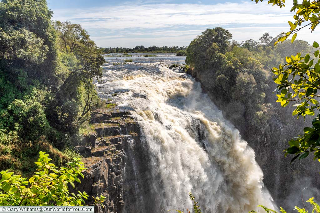 Water flowing over the narrow Devil's Cataract at the far end of the Victoria Falls gorge