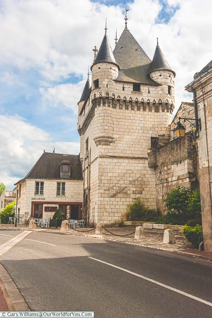 The white stone gatehouse, with its grey turreted roof, of the Porte des Cordeliers on the edge of the French town of Loches