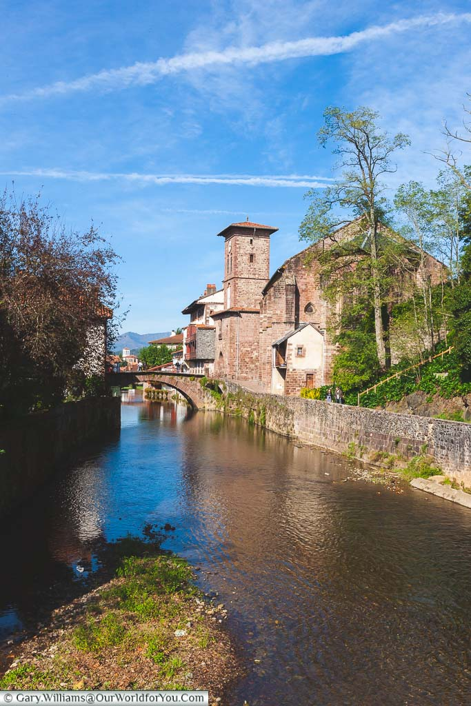 The view of the River Nive towards the Porte Notre-Dame in Saint-Jean-Pied-de-Port in the Pyrénées-Atlantiques region of France