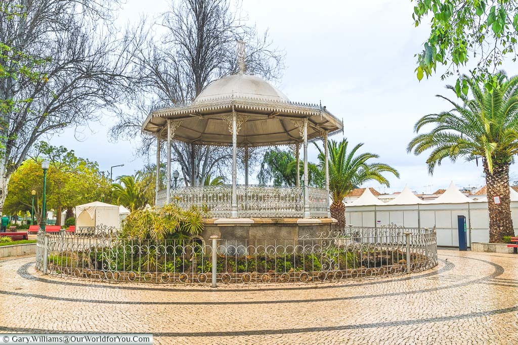 A cast-iron bandstand in the centre of Tavira on an overcast day