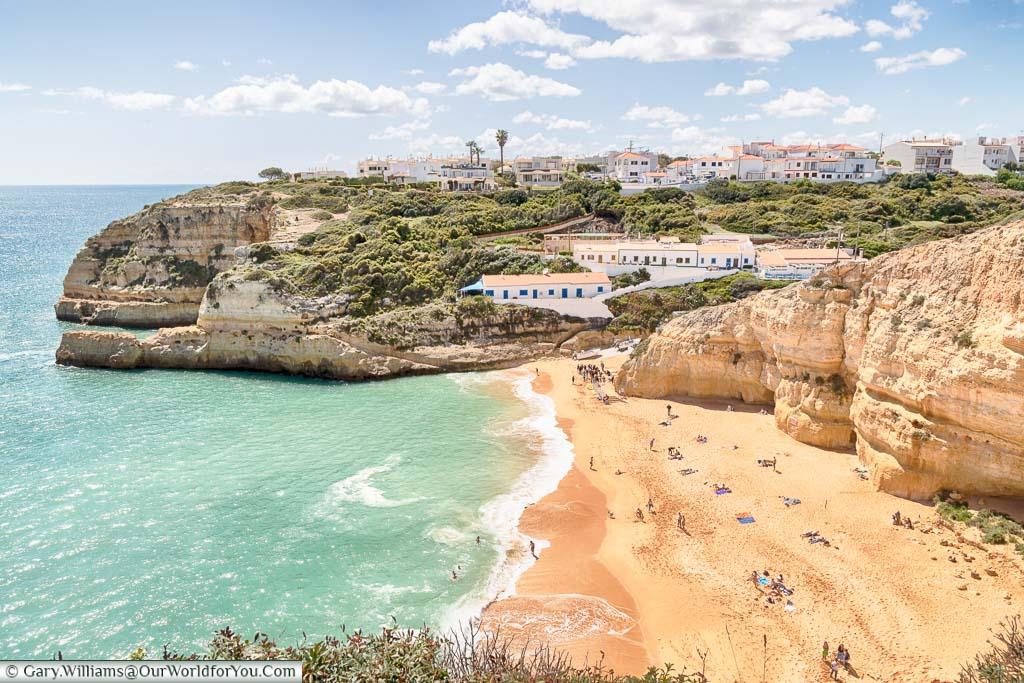 A view over the golden sands of the beach 'Praia de Benagil' on the Algarve coast of Portugal