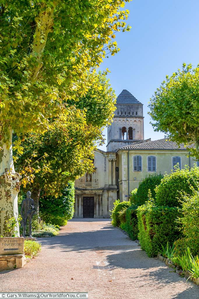 The gravel, tree-lined path to the stone Monastery of Saint-Paul de Mausole in Saint-Rémy-de-Provence, France