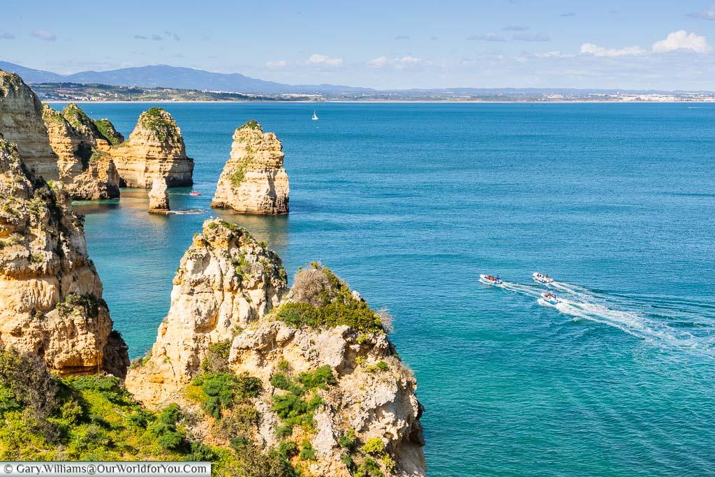 Powerboats off the coast of Ponta da Piedade, just outside Lagos on Portugal's Algarve coast.