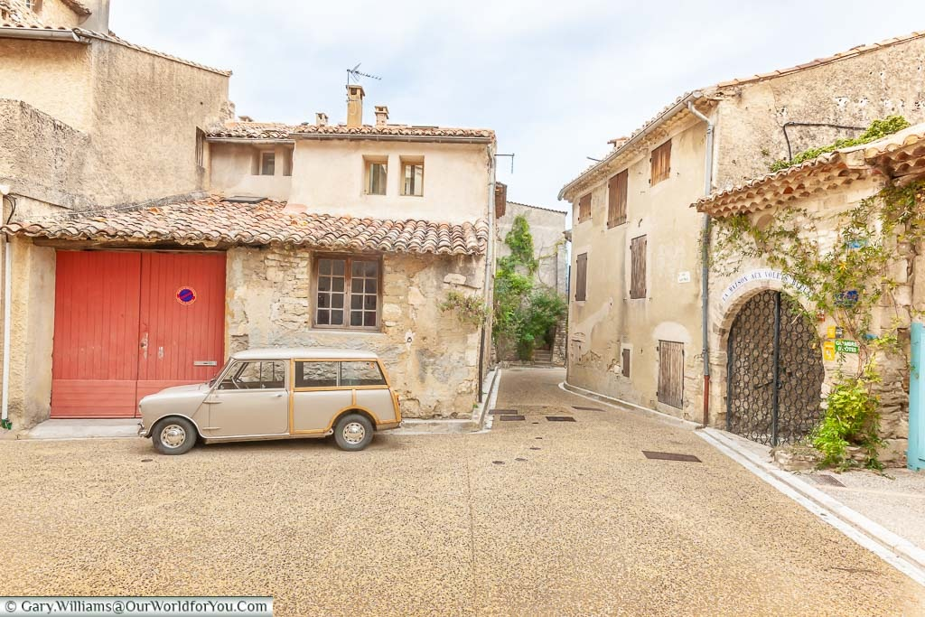 A Mini-Morris traveller parked up in the pretty Provencal town of Venasque in France
