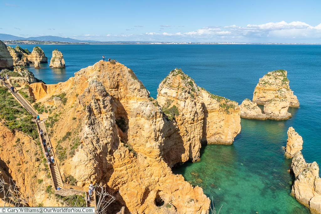 A stairway built into the sandstone rocks at the Ponta da Piedade, leading to the azure blue waters of the Algarve at the southern tip of Portugal